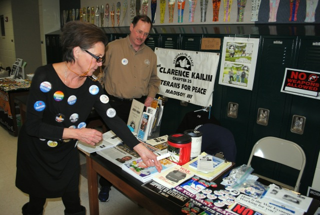 "Veterans for Peace Chapter 25 was well represented by member Steve Books with an informational table at the 8th Annual Wisconsin Progressive Grassroots Festival on Saturday, April 2, 2016, at Wisconsin Heights High School, Mazomanie. Attended by a large crowd, the day-long festival topic was ""Organizing for Change."" The woman pictured was among numerous visitors who examined information provided by Steve. She chose to buy a copy of Smedley Butler's excellent book: ""War Is a  Racket."""